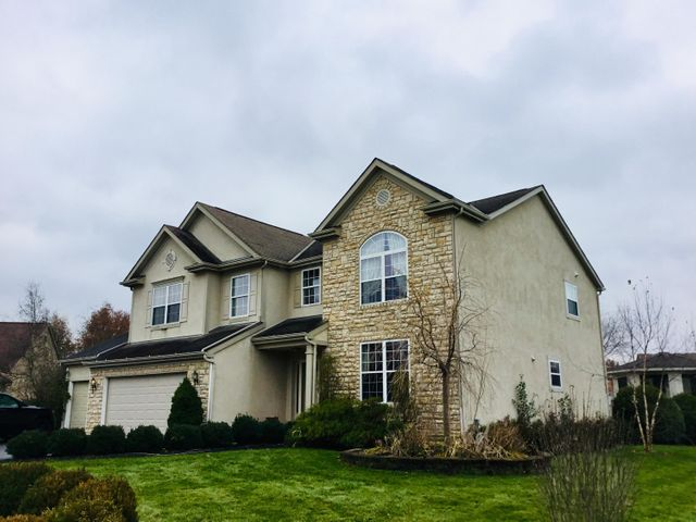 Stately 2 story home in desirable Harrison Pond Subdivision