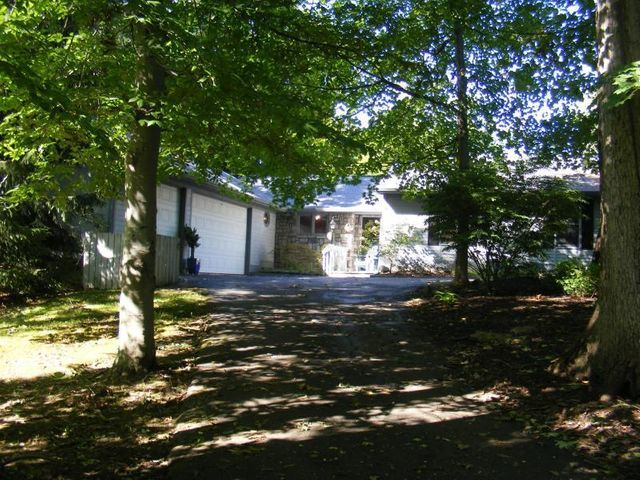 Gorgeous 3 bedroom, 3 and half bath ranch situated on over a acre