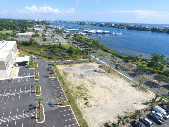Unique opportunity to purchase one acre vacant lot with Hwy 98 frontage in front of brand new Holiday Inn Express hotel. The site is centrally located in Fort Walton Beach: right across from the water (Santa Rosa Sound) and is in very close proximity to FWB City Hall. The approximate traffic count is 45,000. Owners would consider ground lease or build-to -suit lease as well. Buyer to verify all information.