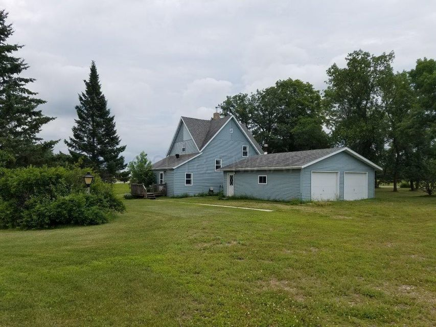 Don't miss your chance to have 20 acres in beautiful rural Detroit Lakes!  This  home has a charming feel, along with many updates, including new furnace, central air, water heater and windows.  Nice big back entryway with laundry, and lots of closet space.  A detached two stall heated garage, and 20x24 storage building, plus lots of fruit trees. Great horse property, or  building site, the possibilities  are endless!