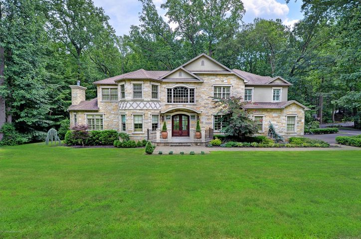 Newly built custom quarrystone colonial over 5400 sq ft w/additional 3300 sq ft basement. Magnificent architecture, nothing left unturned. Steel beems, copper piping, top quality windows, exquisite décor!