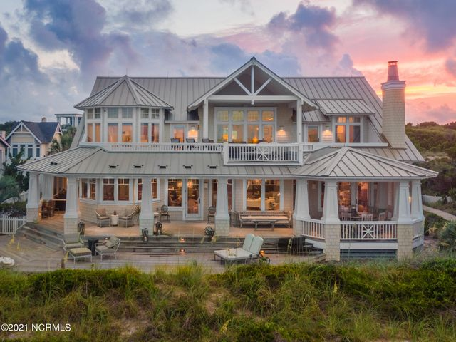 Oceanfront view of main home and spacious decks.