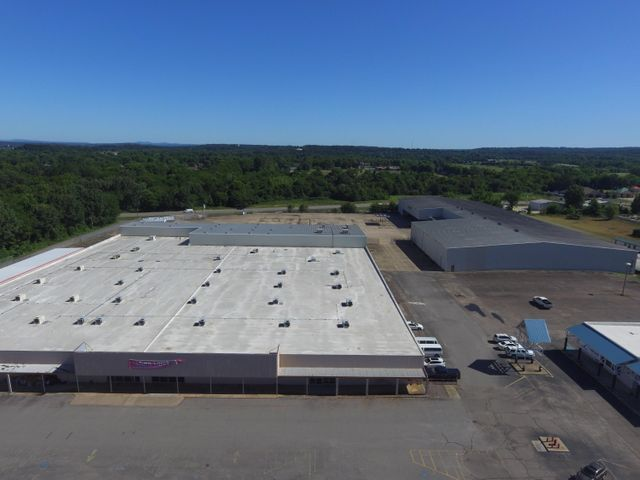 110,000+/- sqft commercial buildings spreading out over an 8 acre lot. Lying in the center of Russellville's major retail and industry side of town is a vanilla box of endless possibilities. Located between 2 high volume traffic areas.  Former location to Wal Mart and National Home Center.