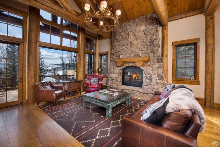 Warm and comfortable mountain home with perfect ski-in/ski-out access to your back door from the Everkrisp Ski-Way. Located in one of the resort's most popular neighborhoods with log detailing both inside and out. Very well-appointed residence with a soft western appeal of cozy furniture and luscious fabrics with a clean and crisp design. Additional family and game room perfect for entertaining. Great outdoor spaces with an over-sized deck and a private patio with your own personal hot tub.