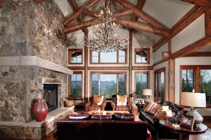 Unparalleled Gore Range views abound from this spectacular mountain residence. Integrated natural stone, reclaimed ash floors, 4 dry stack moss rock fireplaces, and structural log elements provide the feel of a national park lodge. An abundance of space without compromising intimacy.