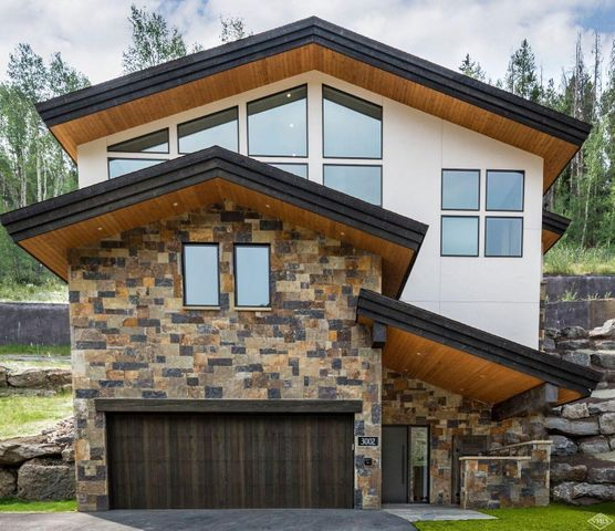 1 of 4 homes new or currently under construction homes at the top of Intermountain. Built out to have contemporary finishes and excellent stonework. Garage will be large enough to fit 4 cars + any toys.; Over 3 Car Garage