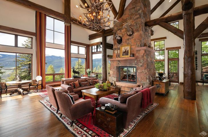 This quintessential mountain retreat features wide open mountain views, direct ski in/out access from the ski run just next to the home, master suite on main with two closets and a large office, 2 story stone fireplace opening to the living and dining rooms, timeless stone and timber finishes, very large chefs kitchen with hearth room and a state of the art exercise room. In the summer you are surrounded by cascading water features which can be seen and heard from every room in the house