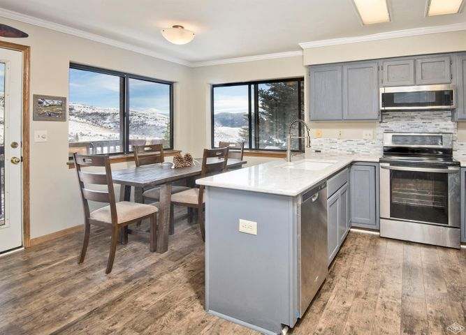 Top of the world views of Beaver Creek & Bachelor Gulch from this 2 bedroom condominium that features new flooring, updated kitchen with quartz countertops, stainless steel appliances, loads of natural light, & a 1-car garage plus a carport! Step out of your door and embrace the incredible hiking & biking trails, watch the wildlife from your deck, & know your only minutes away from the base of Beaver Creek for a powder day or Nottingham Lake to play. This is your opportunity to own and not rent!
