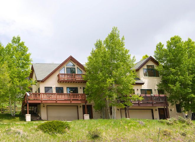 Enjoy incredible Colorado evenings with friends and family during gatherings from your large wrap-around deck. Beautiful Wildridge duplex boasts four beds with en-suite bathrooms, oversize 2-car garage and great finishes including maple hardwood floors, granite kitchen counters and a stone fireplace. Fenced yard for dogs. Take advantage of Wildridge with the Avon Preserve mountain bike/hiking trails, pocket parks, southern views, excellent sunshine and easy access to restaurants and shops!