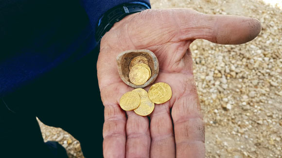 1,100-year-old gold dinars from the early Abbasid period found inside a juglet in Yavne, Israel. Image credit: Liat Nadav-Ziv, Israel Antiquities Authority.