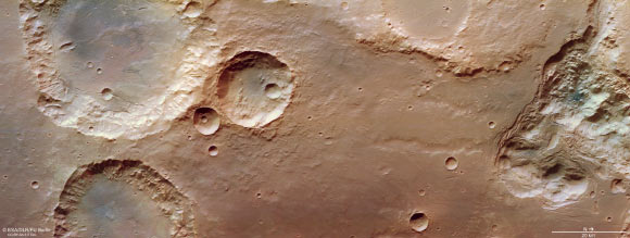 This image of the High Resolution Stereo Camera (HRSC) seated in ESA's Mars Express shows pits, valleys and chaotic terrain in Mars' Pierre Reggio.  Molten ice and silt form chaotic terrain as a migrating subsurface layer and cause the upper surface to collapse.  The chaotic terrain seen here has melted the ice, resulting in flooding, and many different broken blocks are now standing in empty cavities (which once housed the ice).  This image contains information collected by HRSC on August 3, 2020.  Image Credit: ESA / DLR / FU Berlin / CC BY-SA 3.0 IGO.