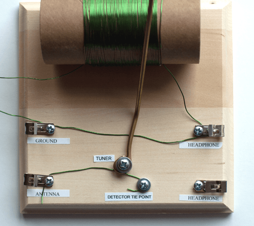 Metal wire connects the tuning rod screw to the antenna and detector tie point in a homemade crystal radio