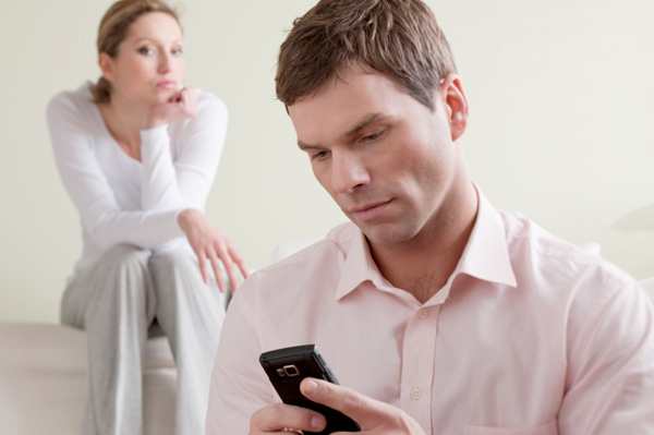 Jealous woman listening on husband's phone converstaion
