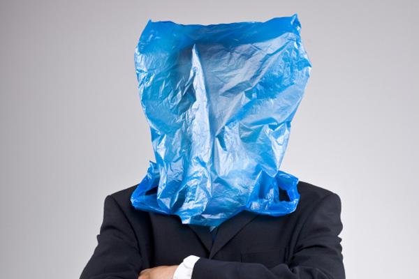 Man with plastic bag overhead