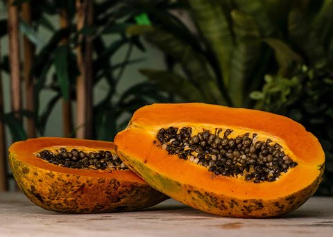 Cut papaya on a table