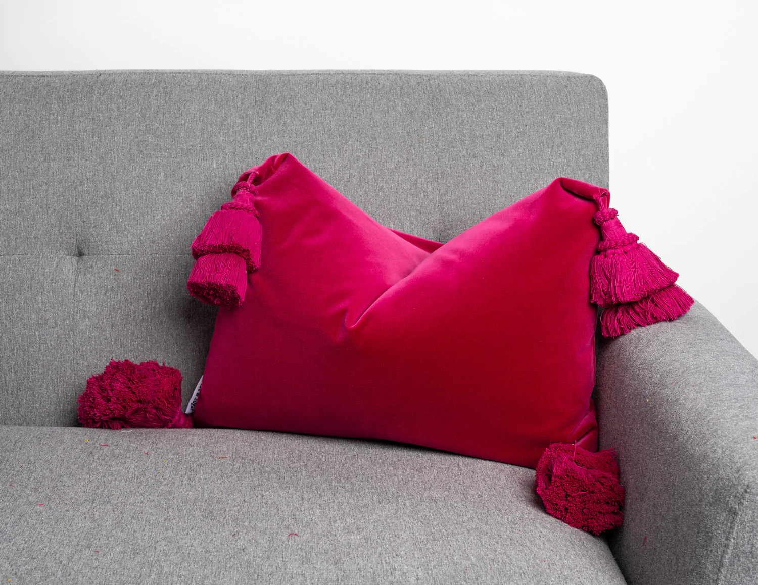 magenta pink pillow cover with handmade tassels