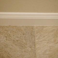 does tile go under baseboards