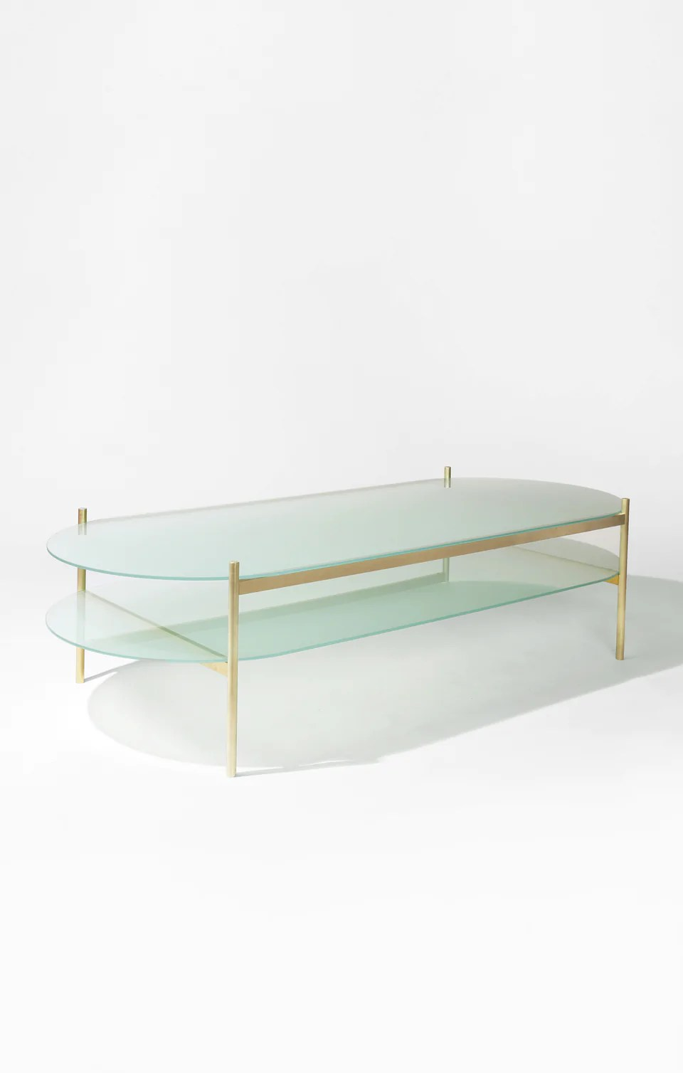 duotone pill coffee table brass frame frosted glass frosted glass