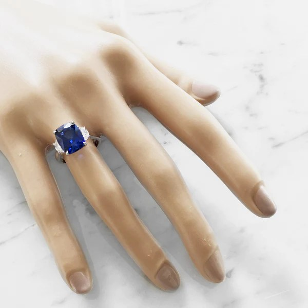 Alexandra 4 Carat Blue Sapphire Ring With Half Moon Side
