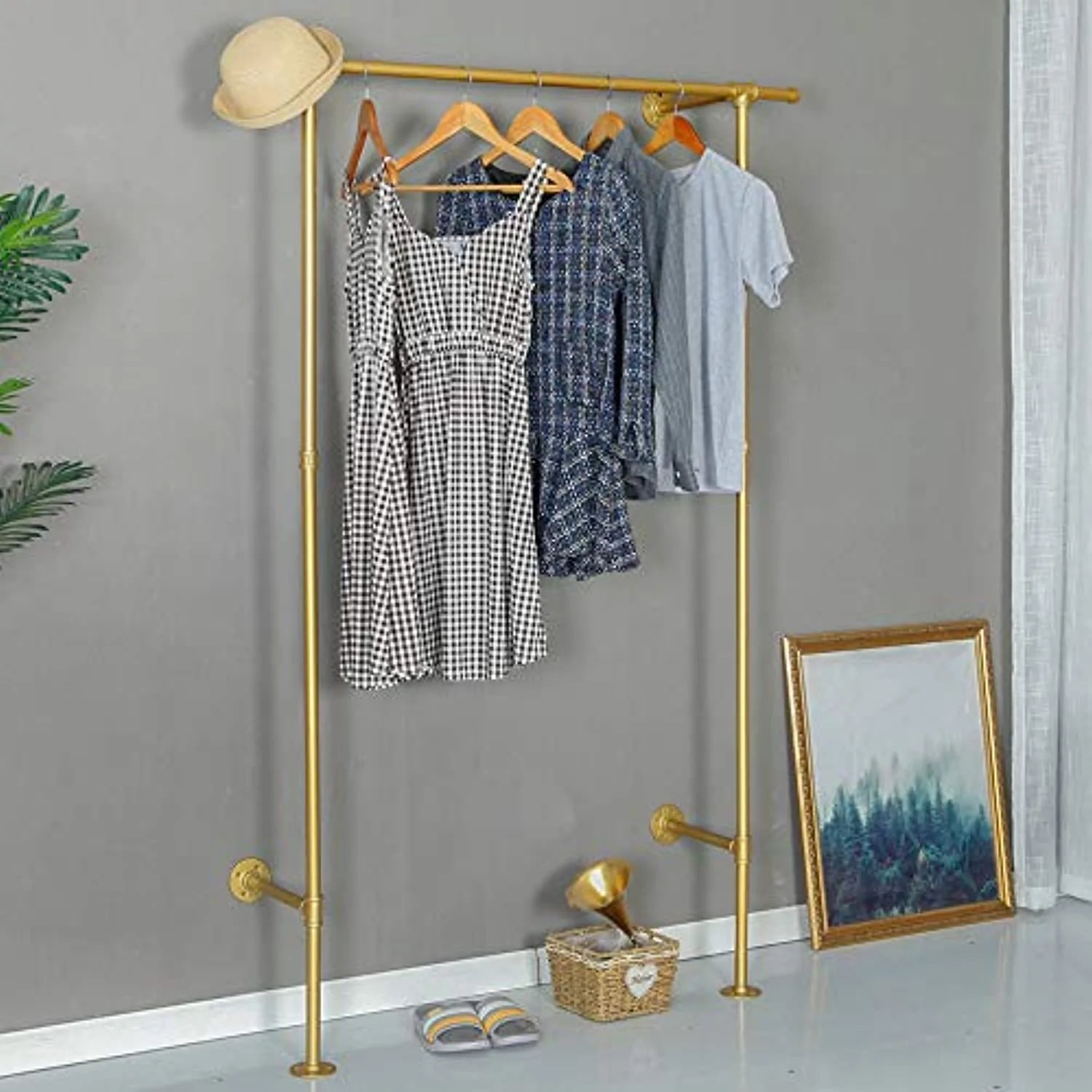 industrial pipe clothing vintage rolling rack on wall gold