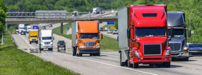 Semi Trucks driving down the interstate - commercial drivers