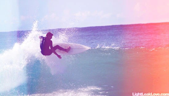 surfing footage with light leak film burn effects
