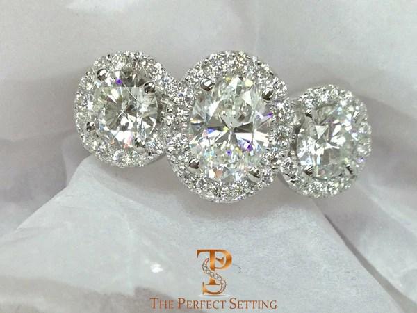 Three Stone Oval Diamond Halo Ring The Perfect Setting