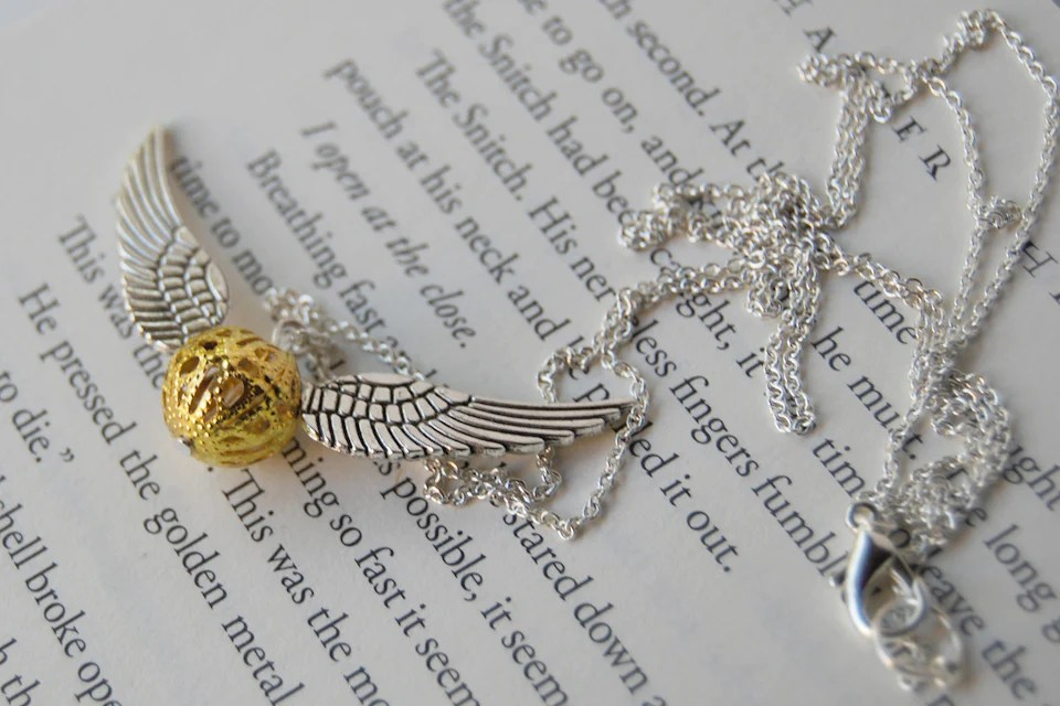 Open At The Close Golden Snitch Necklace Enchanted Leaves