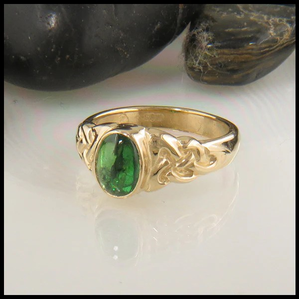 Celtic Trinity Knot Ring With Oval Gemstone In Gold