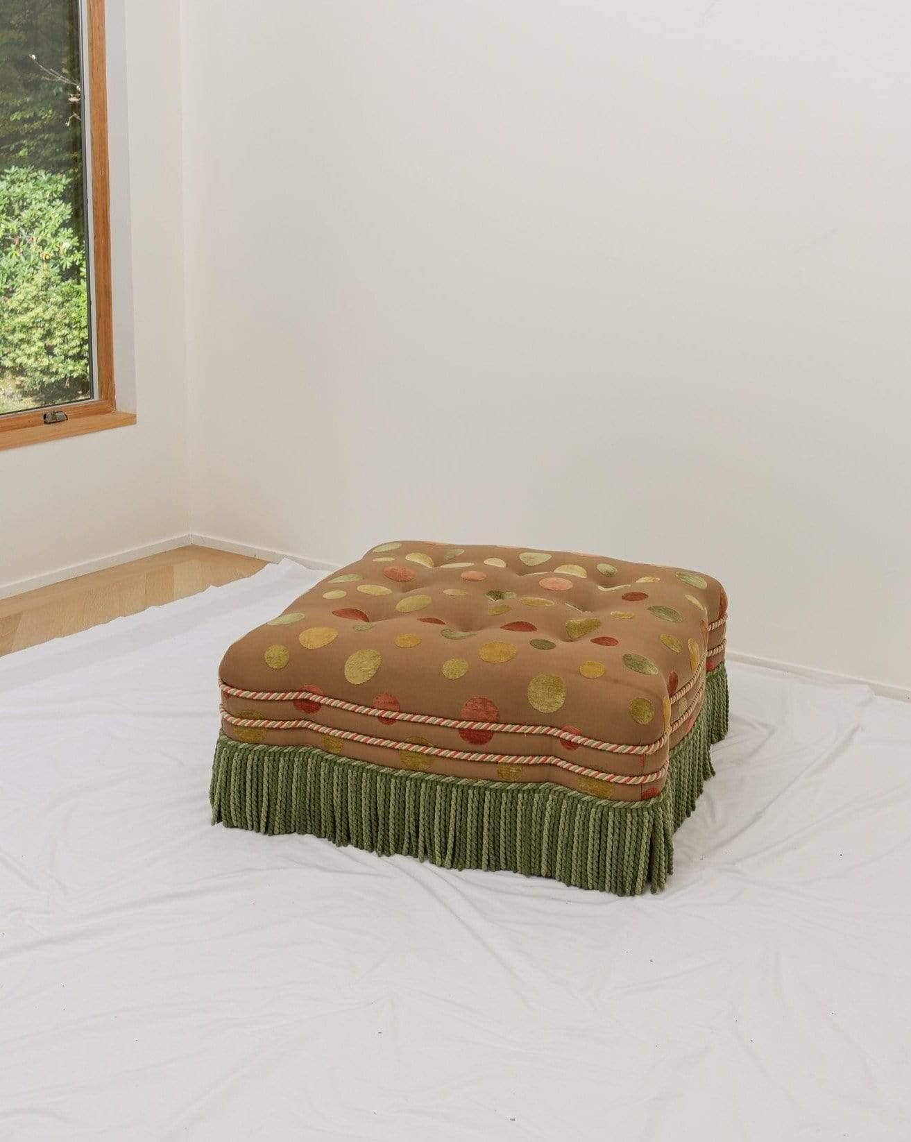 custom upholstered tufted ottoman with fringe detail