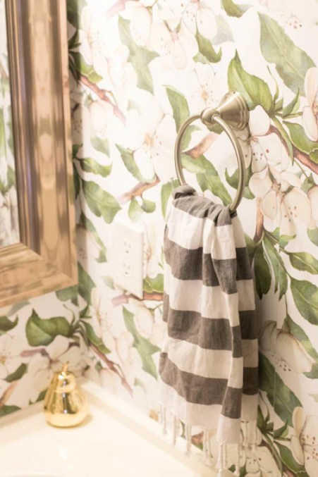 Amy used our Painted Magnolia Removable Wallpaper to update her powder room.