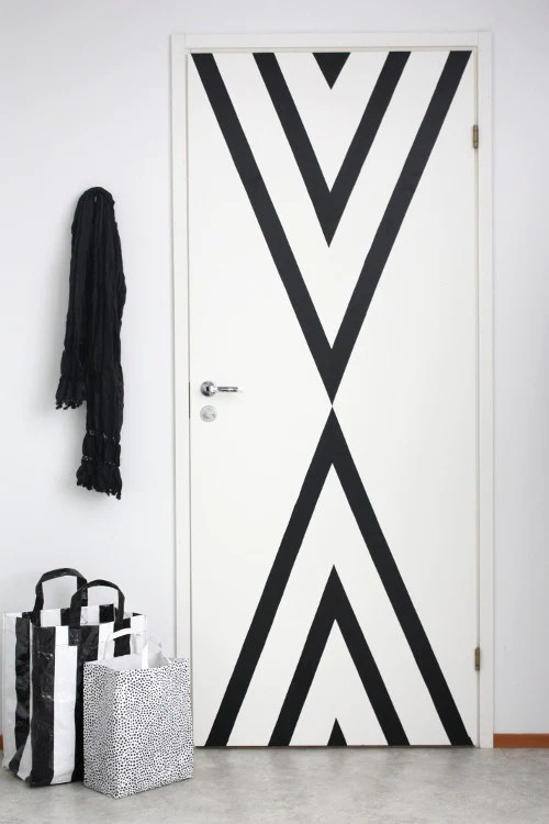7b Unexpected Things to Stripe with Easy Stripe by @wallsneedlove | Use vinyl striping to add interest to a door! Super cool DIY