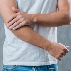 man holding arm