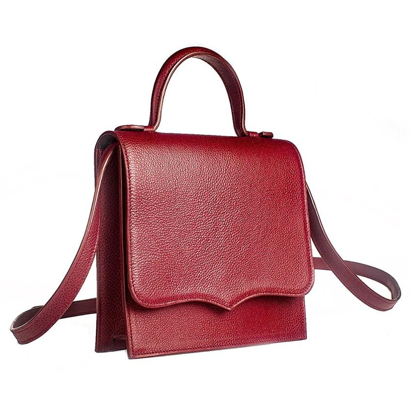 Angled view of red leather handbag