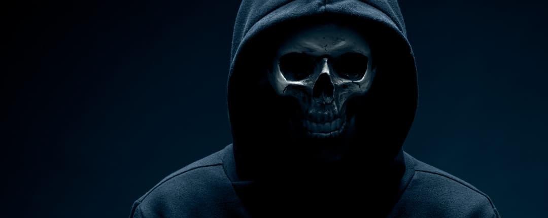 Men hidding behind a Skull mask