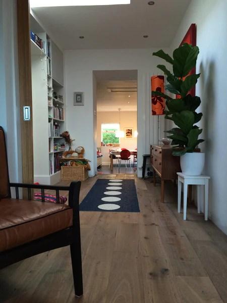Built in bookcase, open plan living, wooden flooring, pappelina rug