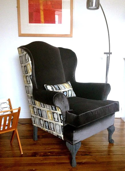 upholstered vintage wing back chair