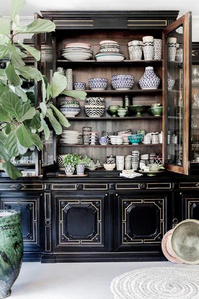ceramic collection in black vintage dresser