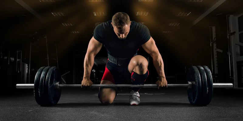 man deadlifting for hamstrings