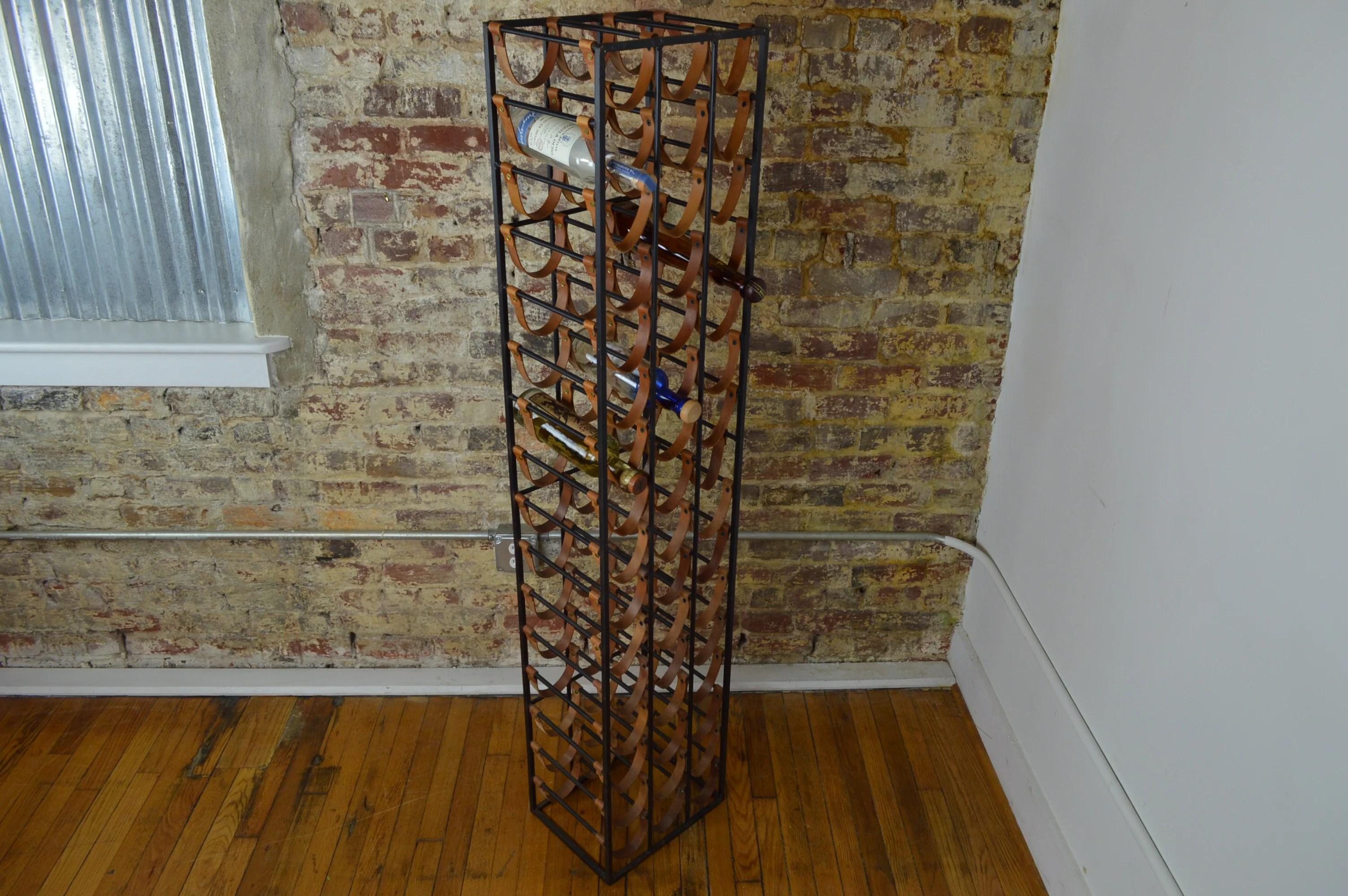 arthur umanoff mid century iron and leather wine rack
