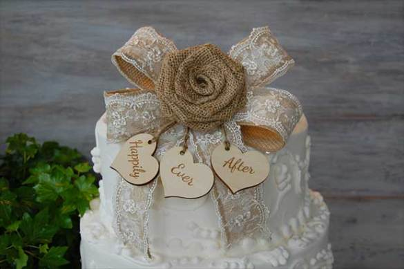 10 Rustic Wedding Cake Toppers   Real Country Ladies Complement a barn wedding with this burlap and lace rose cake topper and  little wooden hearts that can be personalized with the first names of the  happy