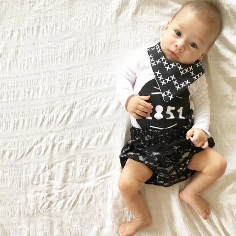 Baby boy in Eighteen Fifty One Black Luxe Lace Bloomers and custom printed onesie from Grunge and Lace