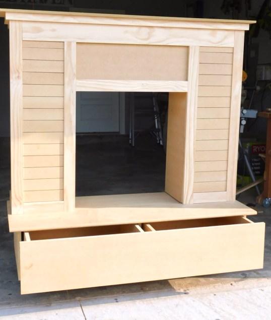 FullSizeRender 55 1024x1024 - Faux Fireplace with Hidden Storage