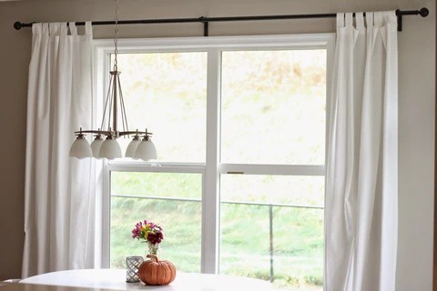 how to measure for curtain rod brackets