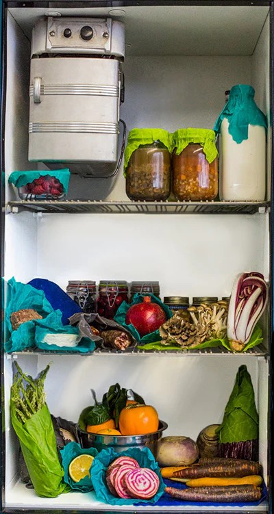 Organic paper wrapping food in a refrigerator.