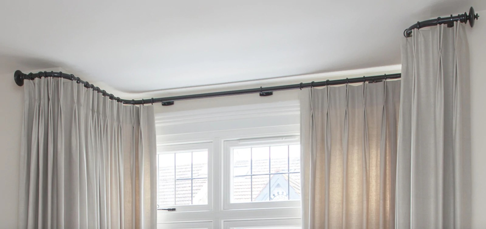 bay window curtain poles made to