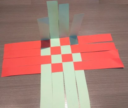 Folding the side strips up at a 90-degree angle