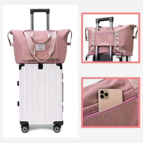Kannettava kassi kiinnitettynä matkalaukun päälle