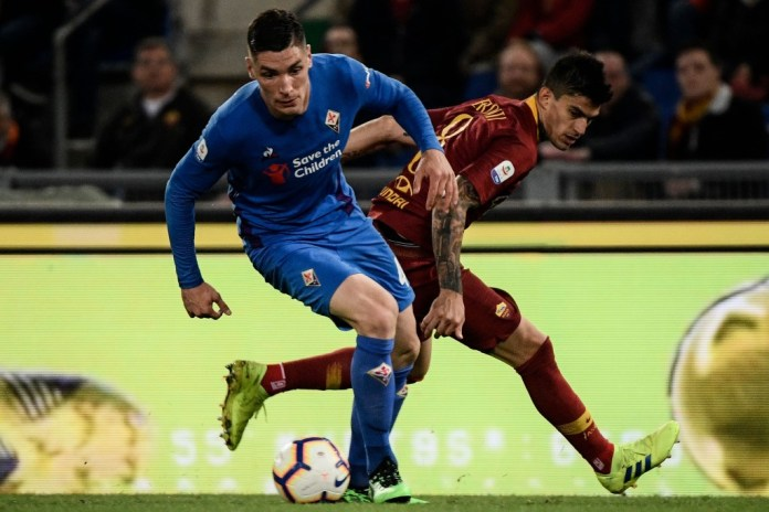 Fiorentina's Serbian defender Nikola Milenkovic (L) works around AS Roma Argentine forward Diego Perotti during the Italian Serie A football match AS Roma vs Fiorentina on April 3, 2019 at the Olympic stadium in Rome. (Photo by Filippo MONTEFORTE / AFP) (Photo credit should read FILIPPO MONTEFORTE/AFP/Getty Images)