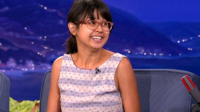 Charlyne Yi in a purple-white top at an interview.